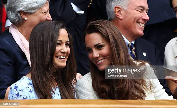 Pippa Middleton and Catherine Duchess of Cambridge sit in the Royal Box during the Gentlemen's Singles final match between Roger Federer of...