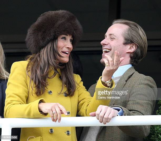 Pippa Middleton and friend Tom Kingston watch the races on day 3 of the Cheltenham Festival at Cheltenham Racecourse on March 14 2013 in Cheltenham...