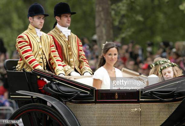 Pippa Middleton and Grace Van Cutsem travel down The Mall on route to Buckingham Palace in a horse drawn carriage following Prince William Duke of...
