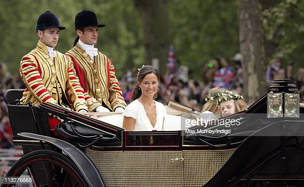 Pippa Middleton and Grace Van Cutsem travel down The Mall on route to Buckingham Palace in a horse drawn carriage following Prince William, Duke of...