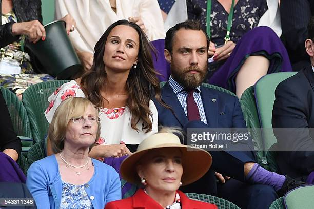 Pippa Middleton and her brother James Middleton watch on from the stands during the Men's Singles first round match between Novak Djokovic of Serbia...