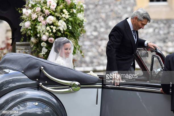 Pippa Middleton and her father Michael Middleton arrive at the wedding of Pippa Middleton and James Matthews at St Mark's Church on May 20, 2017 in...