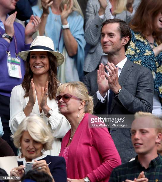 Pippa Middleton and her husband James Matthews applaud Roger Federer after his win on day eleven of the Wimbledon Championships at The All England...