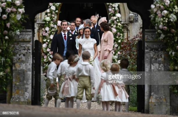 Pippa Middleton and her new husband James Matthews leave church following their wedding ceremony at St Mark's Church as the bridesmaids and pageboys...