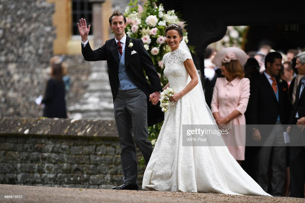 Pippa Middleton and her new husband James Matthews leave church following their wedding ceremony at St Mark's Church as the bridesmaids and pageboys walk ahead on May 20, 2017 in Englefield Green, England.