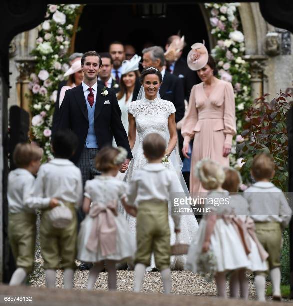 Pippa Middleton and her new husband James Matthews leave St Mark's Church in Englefield, west of London, on May 20 following their wedding. After...
