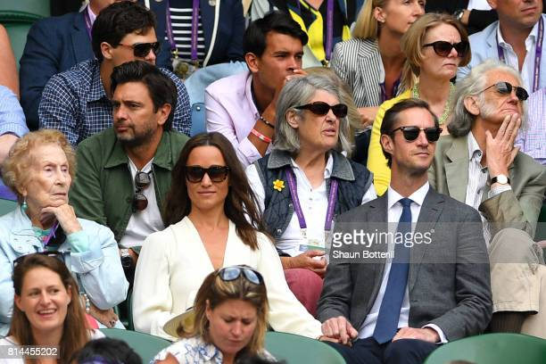 Pippa Middleton and husband James Matthews watch the action during the Gentlemen's Singles semi final match between Sam Querrey of The United States...