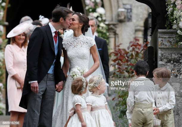 Pippa Middleton and James Matthews kiss after their wedding at St Mark's Church on May 20 2017 in Englefield England Middleton the sister of...