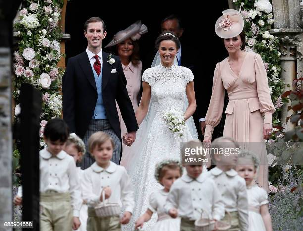 Pippa Middleton and James Matthews smile as they are joined by Catherine Duchess of Cambridge right after their wedding at St Mark's Church onMay 20...