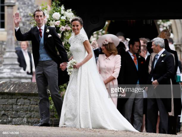 Pippa Middleton and James Matthews smile for the cameras after their wedding at St Mark's Church on May 20 2017 in Englefield England Middleton the...