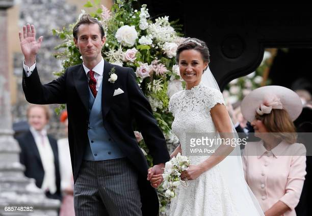 Pippa Middleton and James Matthews smile for the cameras after their wedding at St Mark's Church on May 20, 2017 in Englefield, England. Middleton,...