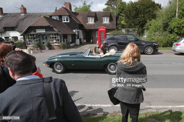 Pippa Middleton and James Matthews wave as they drive a Jaguar EType after their wedding dubbed the society wedding of the year at St Mark's church...