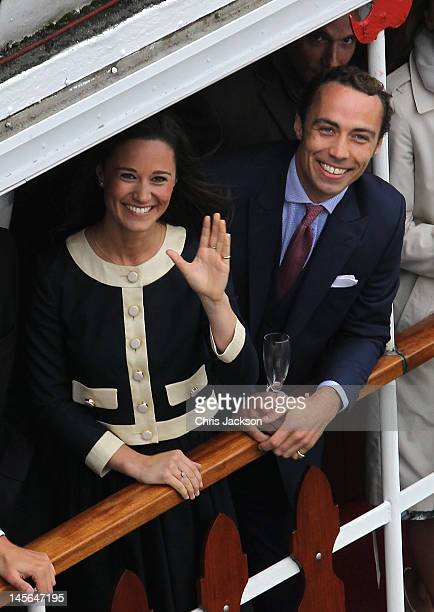 Pippa Middleton and James Middleton wave from the Spirit of Chartwell during the Diamond Jubilee Thames River Pageant on June 3 2012 in London...