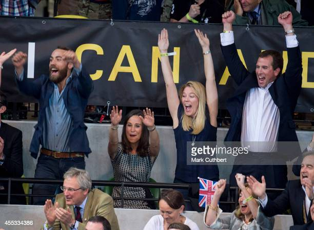 Pippa Middleton and James Middleton with Peter Phillips and Autumn Phillips cheer on Team GB in the final of Wheelchair Rugby during The Invictus...