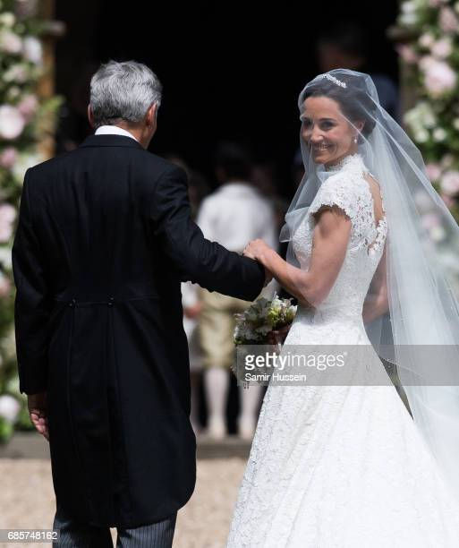 Pippa Middleton and Michael Middleton arrive for the wedding Of Pippa Middleton and James Matthews at St Mark's Church on May 20, 2017 in Englefield...