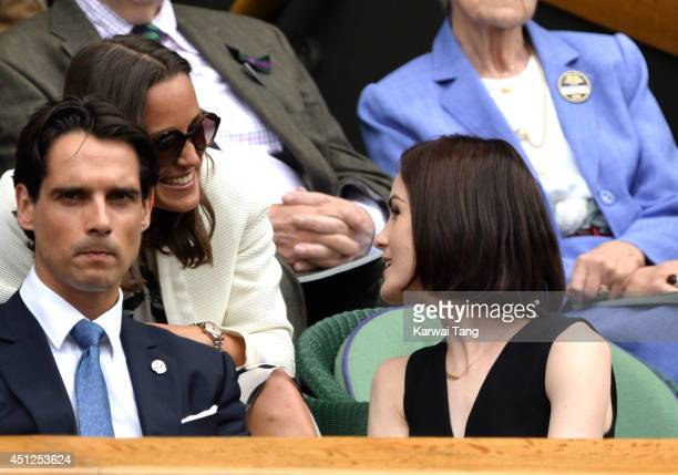 Pippa Middleton and Michelle Dockery attend the Lukas Rosol v Rafael Nadal match on centre court during day four of the Wimbledon Championships at...