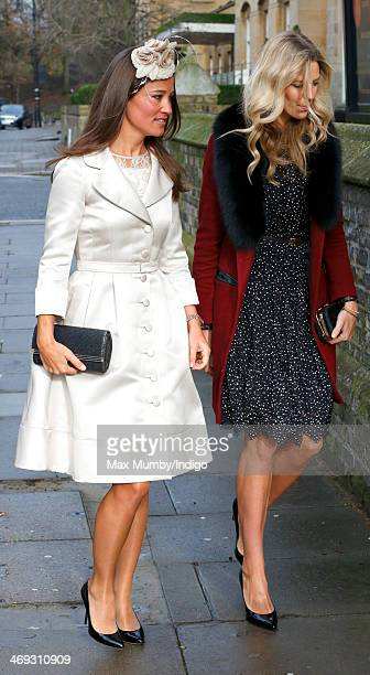 Pippa Middleton and Olivia Hunt attend the wedding of Arabella Musgrave and George GalliersPratt at St Paul's Church Knightsbridge on February 8 2014...