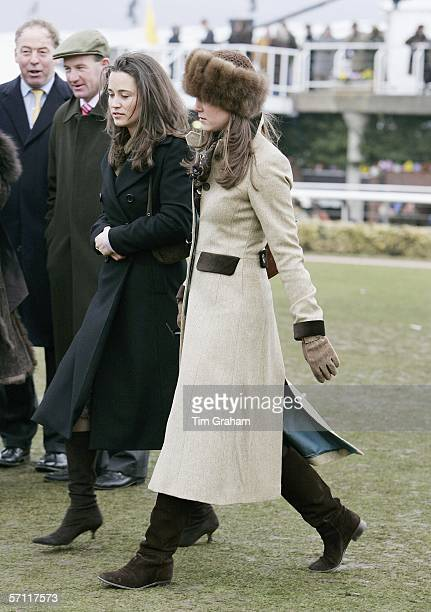 Pippa Middleton and Prince William's girlfriend Kate Middleton, wearing a Russian-style fur hat, attend the final day of Cheltenham Races on March...