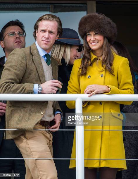 Pippa Middleton and Tom Kingston watch the races from the balcony at the Cheltenham Festival Day 3 at Cheltenham racecourse on March 14 2013 in...