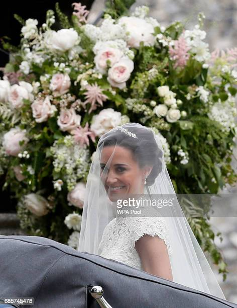 Pippa Middleton arrives for her wedding to James Matthews at St Mark's Church on May 20, 2017 in Englefield, England. Middleton, the sister of...