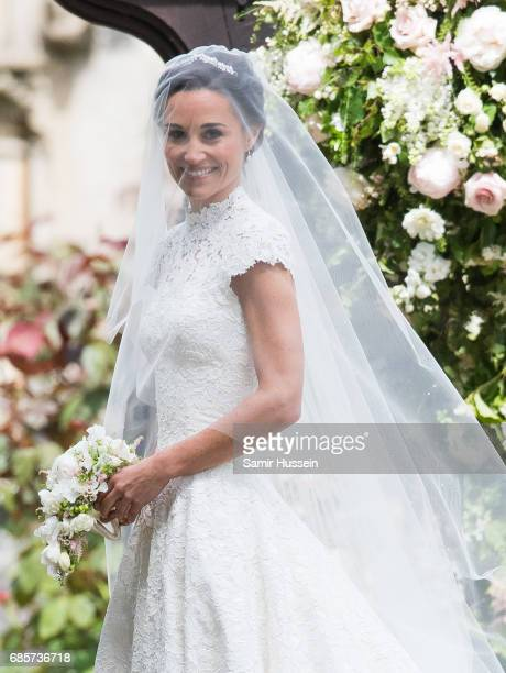 Pippa Middleton arrives for the wedding Of Pippa Middleton and James Matthews at St Mark's Church on May 20, 2017 in Englefield Green, England.