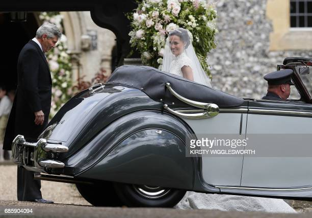 Pippa Middleton arrives with her father Michael Middleton ahead of her wedding to James Matthews at St Mark's Church in Englefield, west of London,...