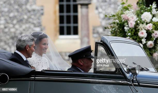 Pippa Middleton arrives with her father Michael Middleton for her wedding to James Matthews at St Mark's Church on May 20 2017 in Englefield England...