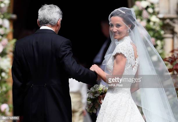 Pippa Middleton arrives with her father Michael Middleton for her wedding to James Matthews at St Mark's Churchon May 20, 2017 in Englefield,...