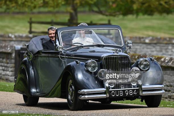 Pippa Middleton arrives with her father Michael Middleton in a 1951 Jaguar Mk V car for her wedding to James Matthews at St Mark's Church in...