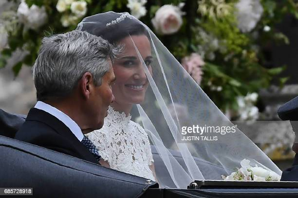 Pippa Middleton, arrives with her father Michael Middleton, in a 1951 Jaguar Mk V car, for her wedding to James Matthews at St Mark's Church in...