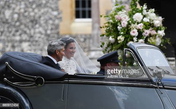 Pippa Middleton, arrives with her father Michael Middleton , in a 1951 Jaguar Mk V car, for her wedding to James Matthews at St Mark's Church in...