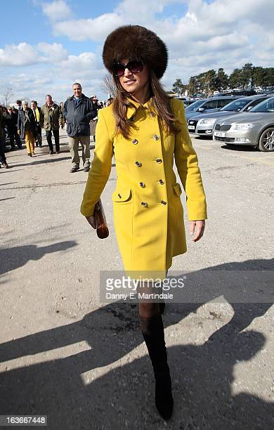 Pippa Middleton attends day 3 of the Cheltenham Festival at Cheltenham Racecourse on March 14 2013 in Cheltenham England
