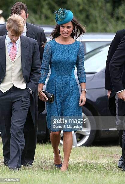 Pippa Middleton attends the wedding of James Meade and Lady Laura Marsham at The Parish Church of St Nicholas in Gaytonon September 14 2013 in King's...