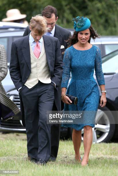Pippa Middleton attends the wedding of James Meade and Lady Laura Marsham at the parish church of St Nicholas in Gayton on September 14 2013 in...
