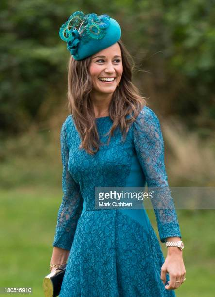 Pippa Middleton attends the wedding of James Meade and Lady Laura Marsham at The Parish Church of St. Nicholas in Gayton on September 14, 2013 in...