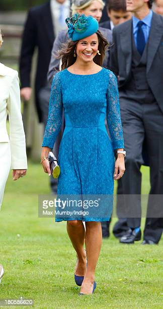 Pippa Middleton attends the wedding of James Meade and Lady Laura Marsham at the Parish Church of St Nicholas in Gayton on September 14 2013 near...
