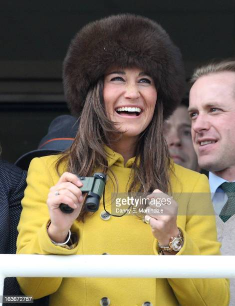 Pippa Middleton celebrates as she watches the Queens Mother Steeple Chase on day 3 of the Cheltenham Festival at Cheltenham Racecourse on March 14...