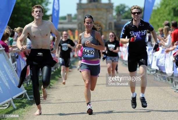 Pippa Middleton crosses the finish line during the GE Blenheim Triathlon at Blenheim Palace on June 4 2011 in Woodstock England