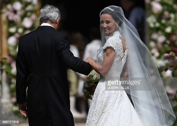 Pippa Middleton, is escorted by her father Michael Middleton, as she arrives for her wedding to James Matthews at St Mark's Church in Englefield,...