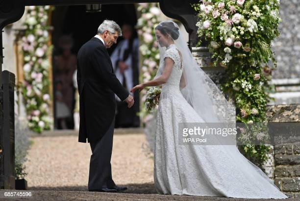 Pippa Middleton is escorted by her father Michael Middleton as she arrives for her wedding to James Matthews at St Mark's Church on May 20, 2017 in...