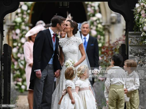 Pippa Middleton kisses her new husband James Matthews, following their wedding ceremony at St Mark's Church in Englefield, west of London, on May 20...