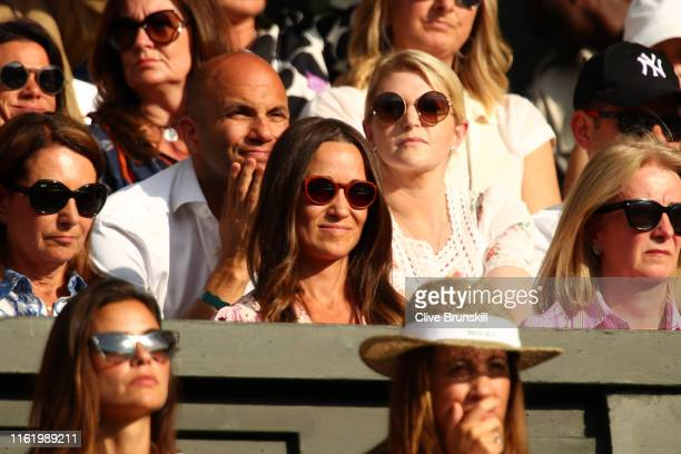 Pippa Middleton looks on as she attends the Men's Singles final between Novak Djokovic of Serbia and Roger Federer of Switzerland during Day thirteen...
