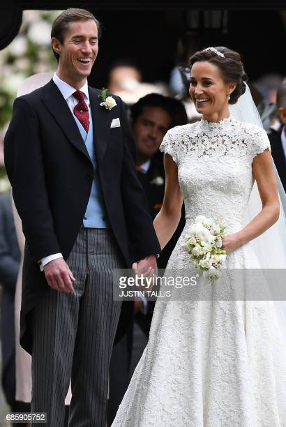 Pippa Middleton reacts following her wedding to James Matthews at St Mark's Church in Englefield, west of London, on May 20, 2017. After turning...