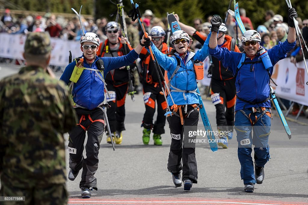 TOPSHOT - Pippa Middleton (C) reacts next to teammates Tarquin Cooper (L) and Bernie Shrosbree as they cross the finish-line of the 'Patrouille des Glaciers' (Glacier Patrol) ski mountaineering race in Verbier on April 20, 2016. Pippa Middleton competed in a team of three racers at the Patrouille des Glaciers organised every two years by the Swiss Army that sees highly-experienced hiker-skiers trek across the Haute Route along the Swiss-Italian border from Zermatt to Verbier. The race covers 53kms (31.8 miles) by foot and ski, with over 7000m gained and lost along the way. / AFP / FABRICE