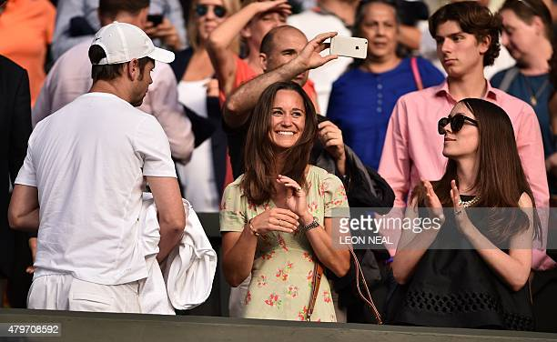 Pippa Middleton sister of Britain's Catherine Duchess of Cambridge reacts after Switzerland's Roger Federer beat Spain's Roberto Bautista Agut in...