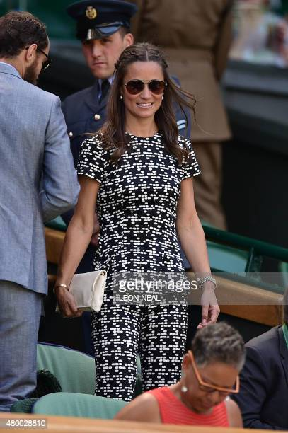 Pippa Middleton sister of Catherine Duchess of Cambridge arrives in the royal box on centre court to watch the women's semifinal matches on day ten...