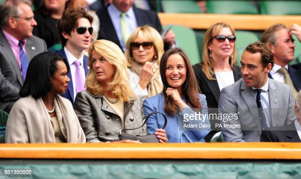 Pippa Middleton sits with her brother James and Dr Condoleezza Rice in the Royal Box during day one of the Wimbledon Championships at The All England...