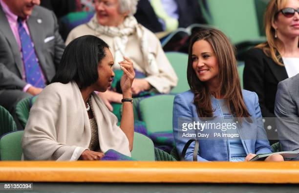 Pippa Middleton speaks with Dr Condoleezza Rice in the Royal Box during day one of the Wimbledon Championships at The All England Lawn Tennis and...