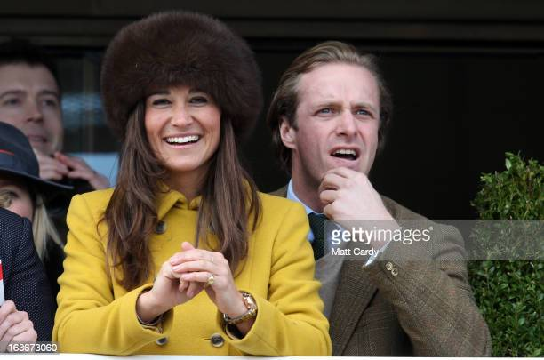 Pippa Middleton watches the racing at Cheltenham Racecourse on the third day of the Cheltenham Festival 2013 on March 14 2013 in Cheltenham England...