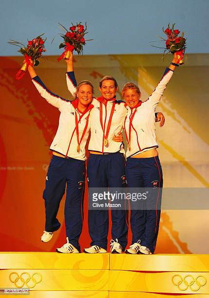 Pippa Wilson Sarah Webb and Sarah Ayton of Great Britain celebrate with their gold medals after winning the Yngling class event held at the Qingdao...